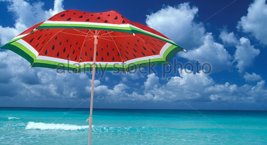 beach-umbrella-and-caribbean-sea-a7bcbw